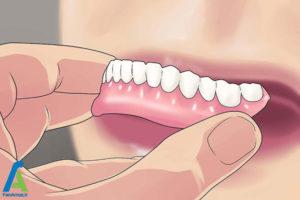 3 جدا کردن چسب دندان مصنوعی از لثه